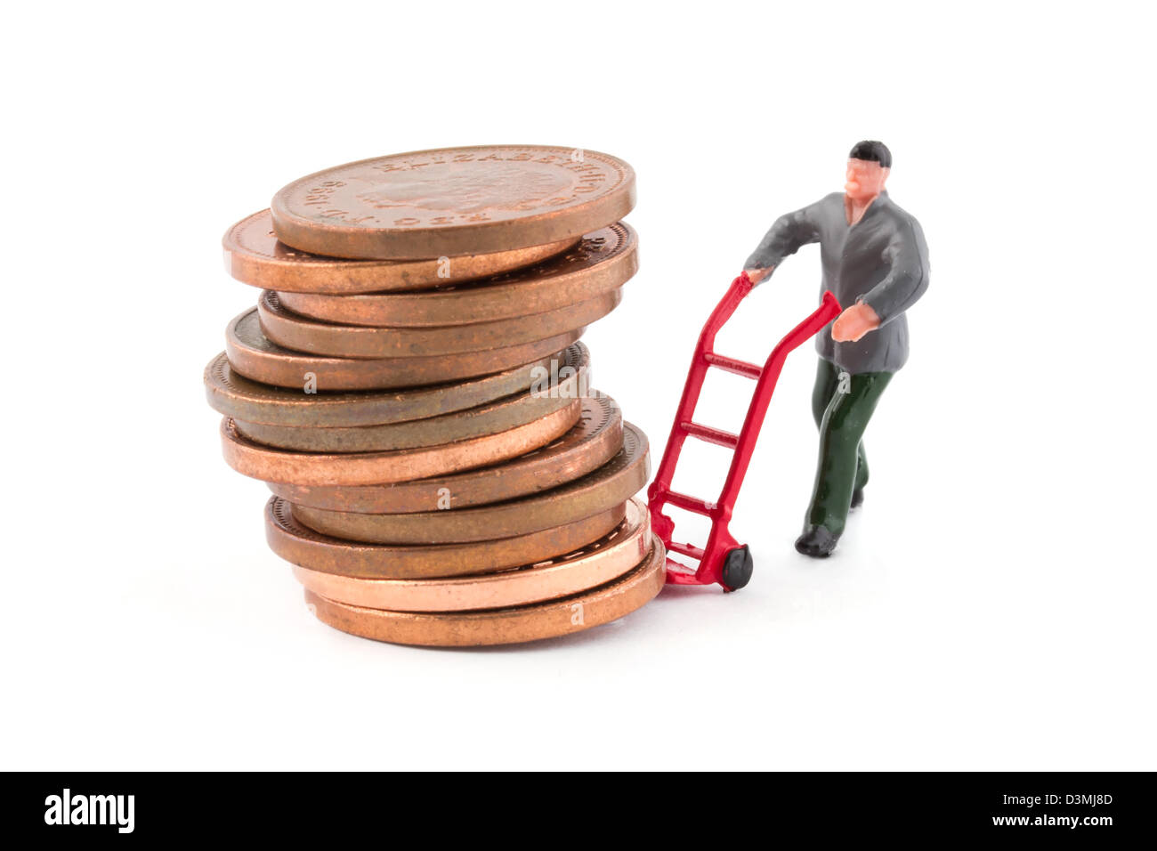 Miniature figure moving a stack of coins on white - Stock Image