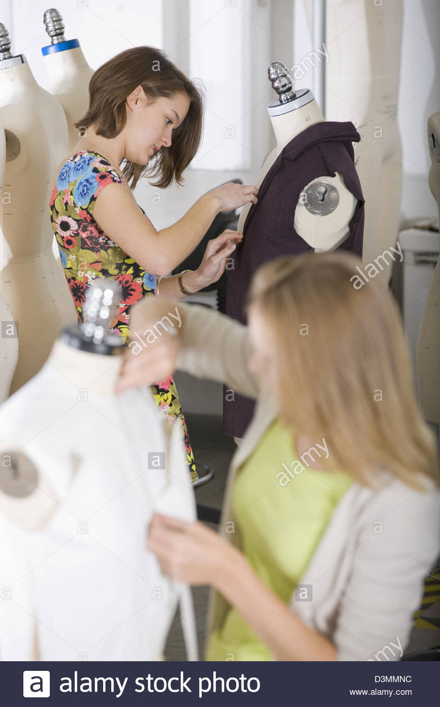 Fashion design student working on garment on mannequin - Stock Image