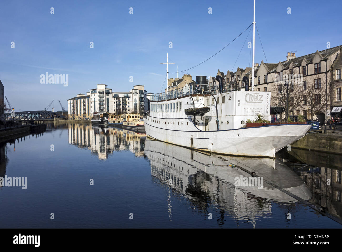 Ristorante de Niro ship (The Cruz) moored at The Shore in Queens Dock Leith Harbour Edinburgh with guests enjoying - Stock Image