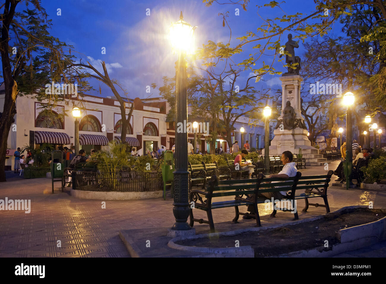 Tourists at colonial square in the evening at Santiago de Cuba, Cuba, Caribbean - Stock Image