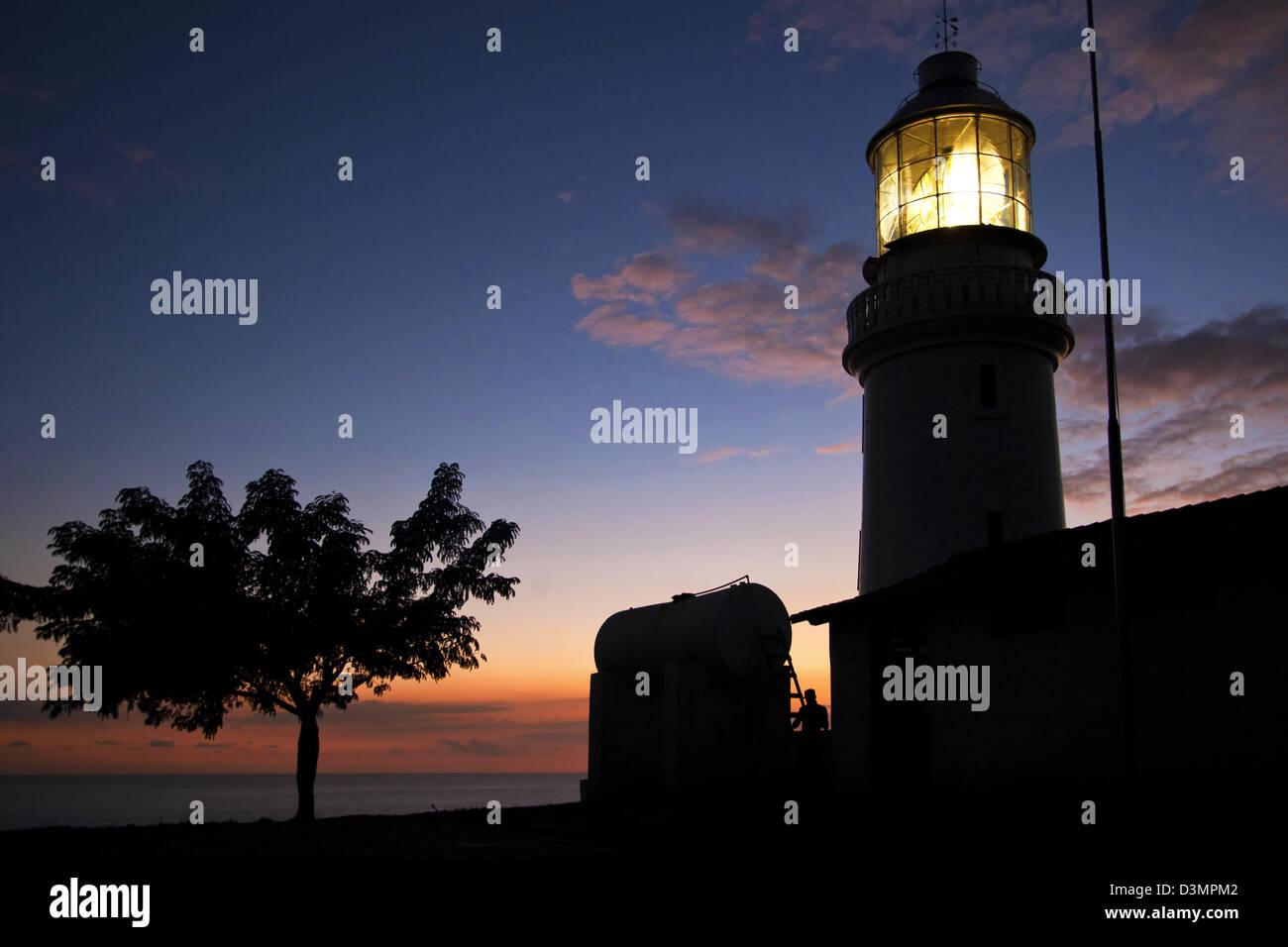 Lighthouse Faro de Morro Santiago de Cuba of the Castillo del Morro / Morro Castle at sunset, Santiago de Cuba, - Stock Image