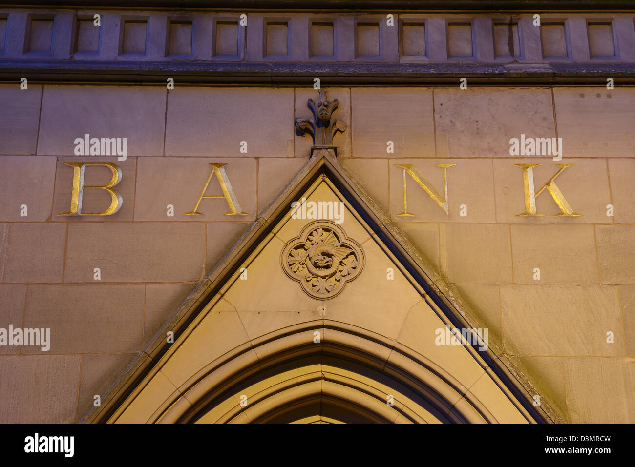 BANK carved into a wall above a doorway - Stock Image
