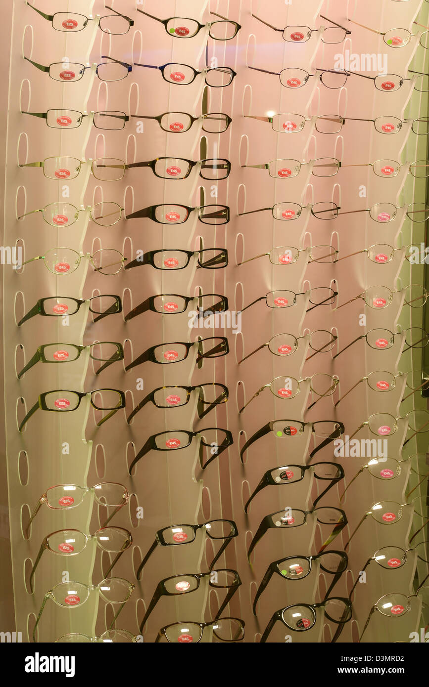 Glasses on display in an opticians - Stock Image