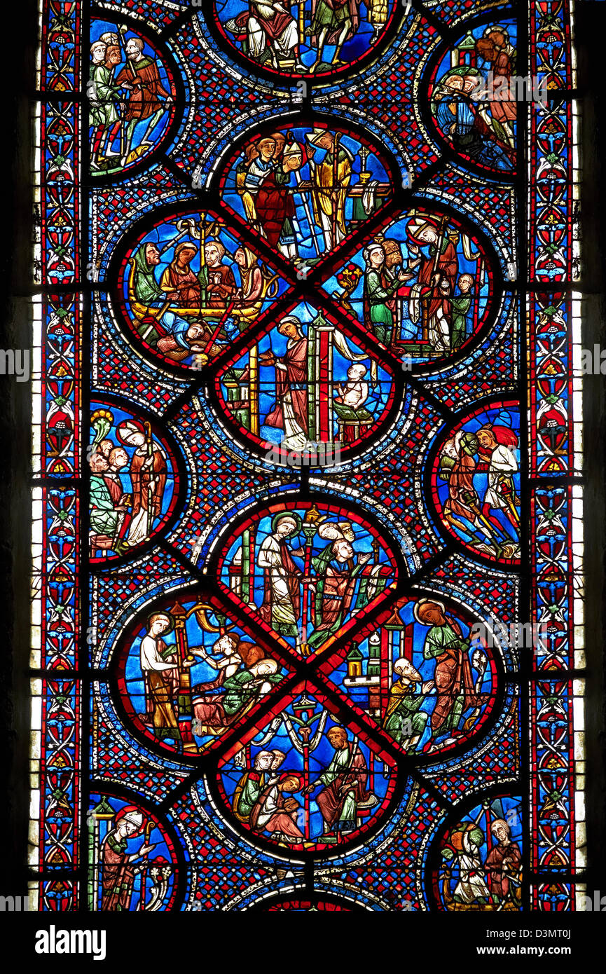 Medieval stained glass Window of the Gothic Cathedral of Chartres, France - dedicated to the Life and Miracles of Stock Photo