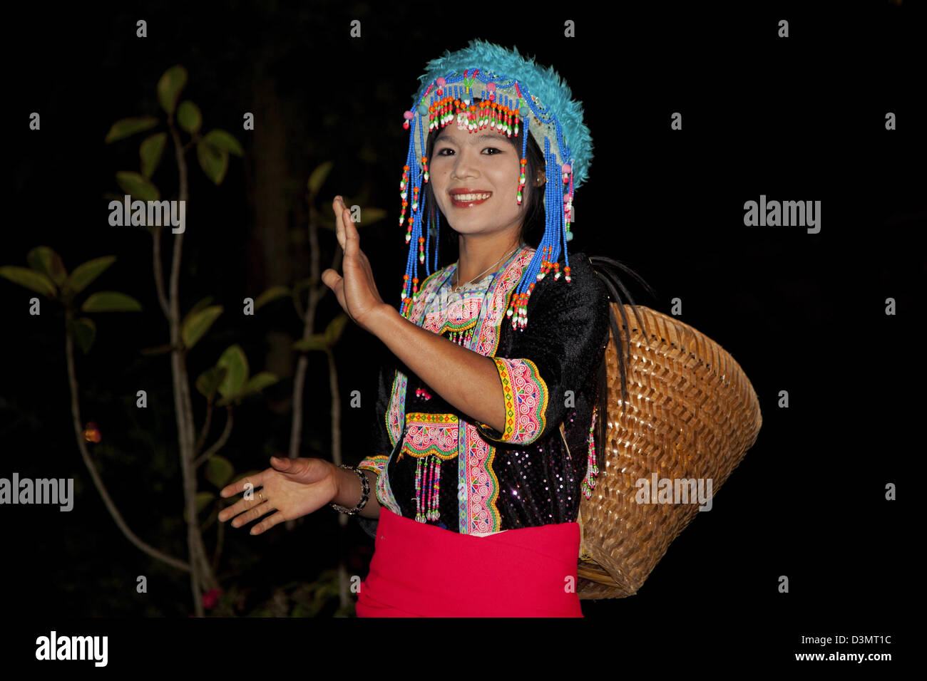 Portrait of traditional tribal dancer wearing headdress with colourful beads, Laos, Southeast Asia - Stock Image