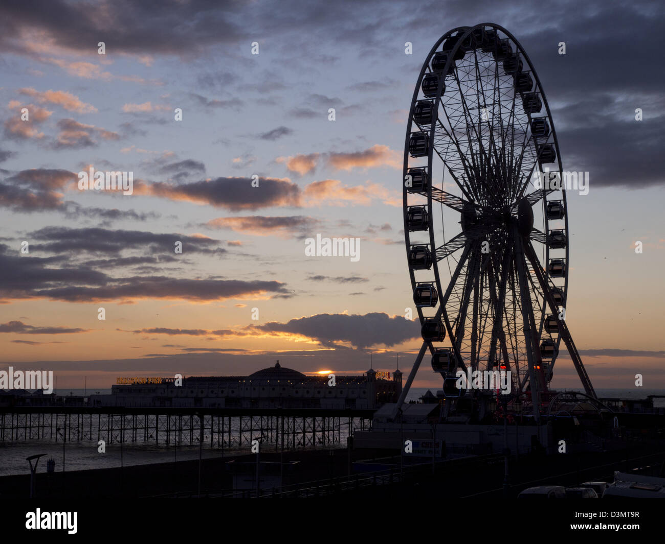 Brighton Eye and Brighton Pier at sunset, Sussex, UK - Stock Image