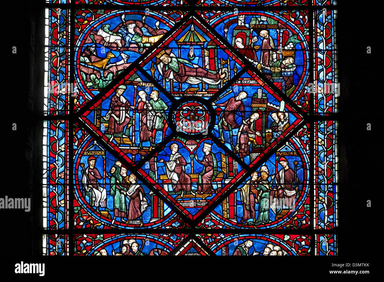 Medieval Windows of the Gothic Cathedral of Chartres, France- dedicated to Joseph the Patriach . - Stock Image