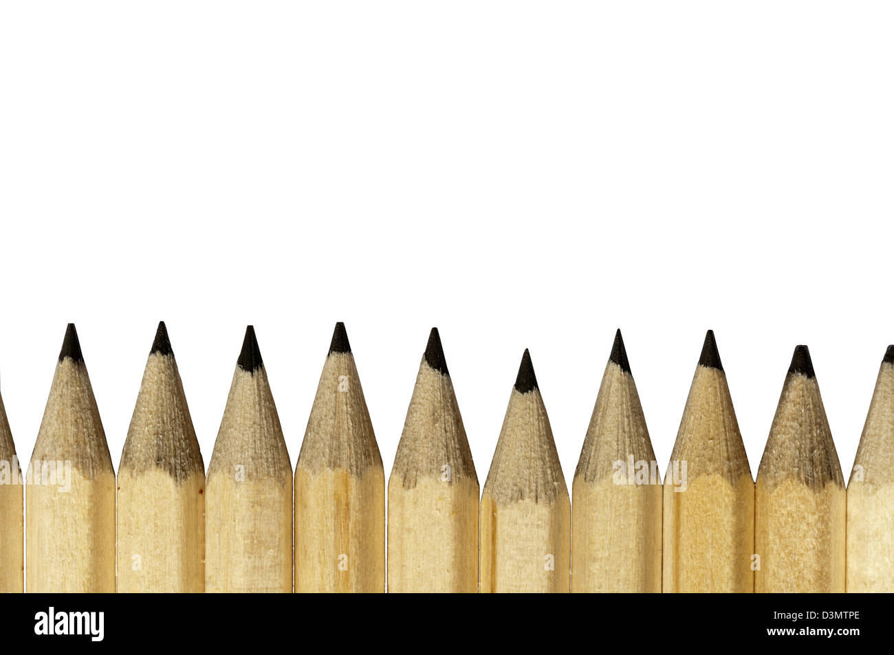 Freshly sharpened points on a line of lead pencils - Stock Image