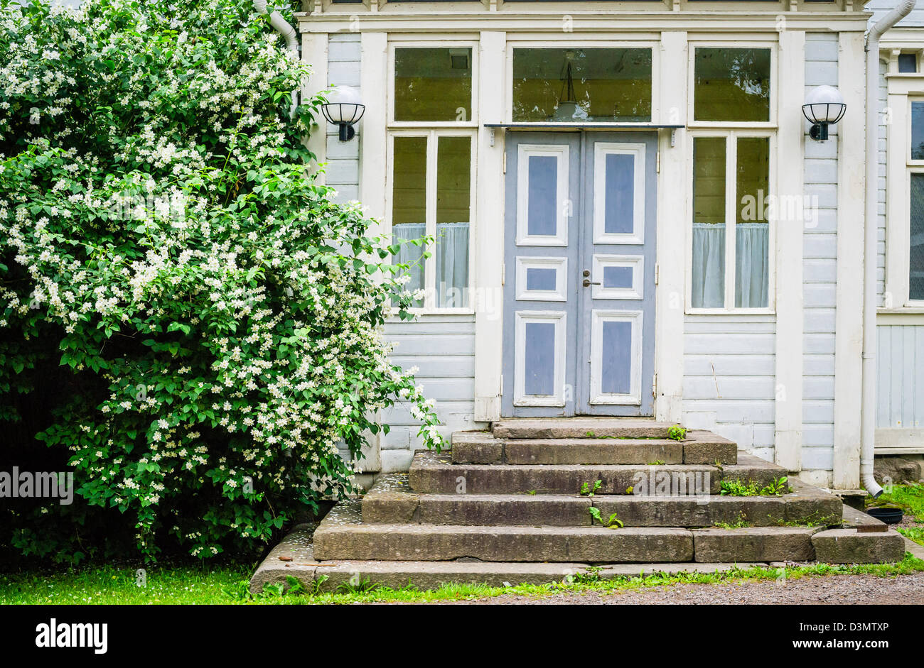 Old idyllic door and entrance to wooden house in Europe Stock Photo