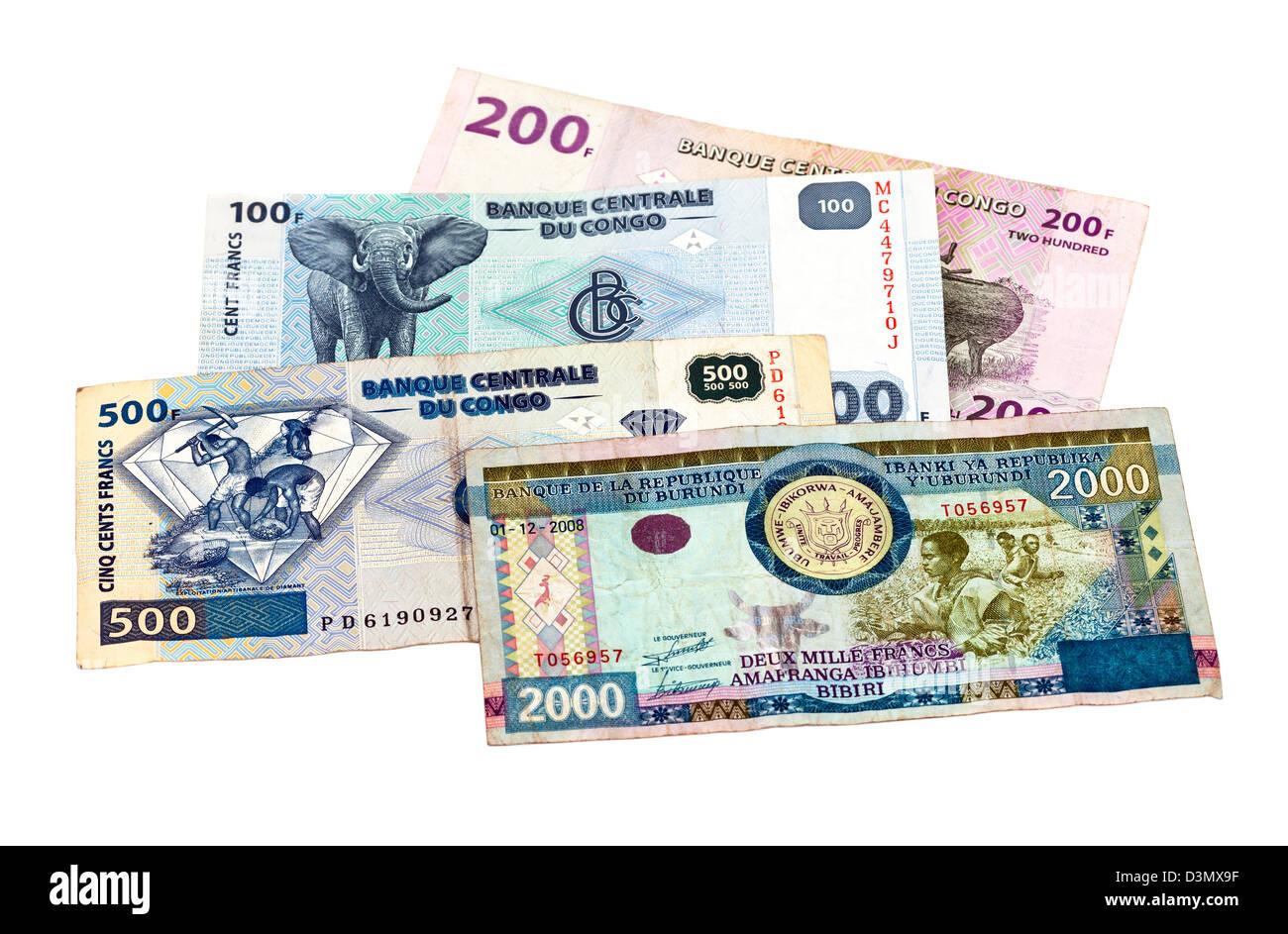 Banknotes of the Congo and Burundi isolated on white background - Stock Image
