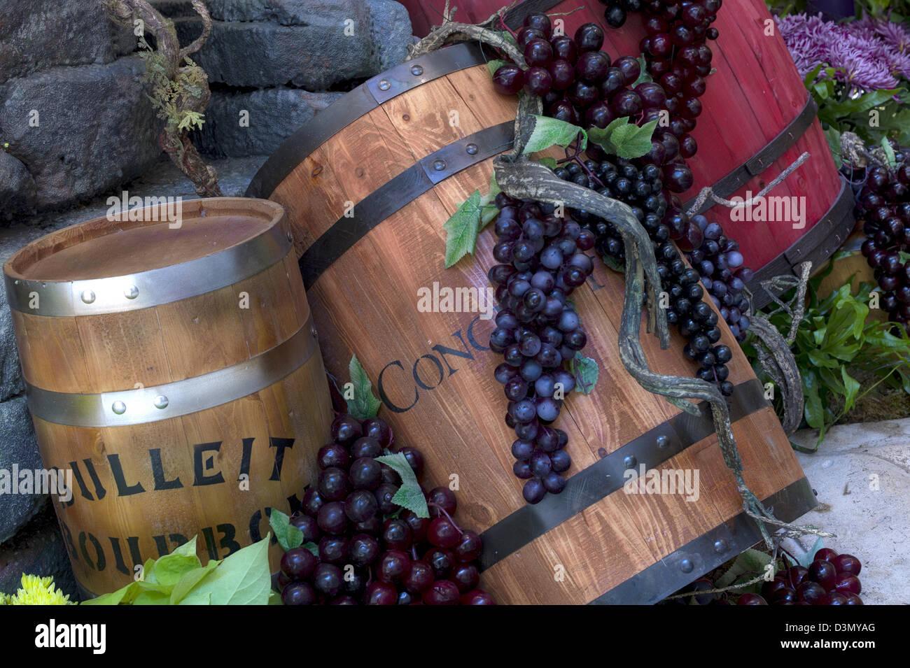 Wine barrel and grape display. - Stock Image