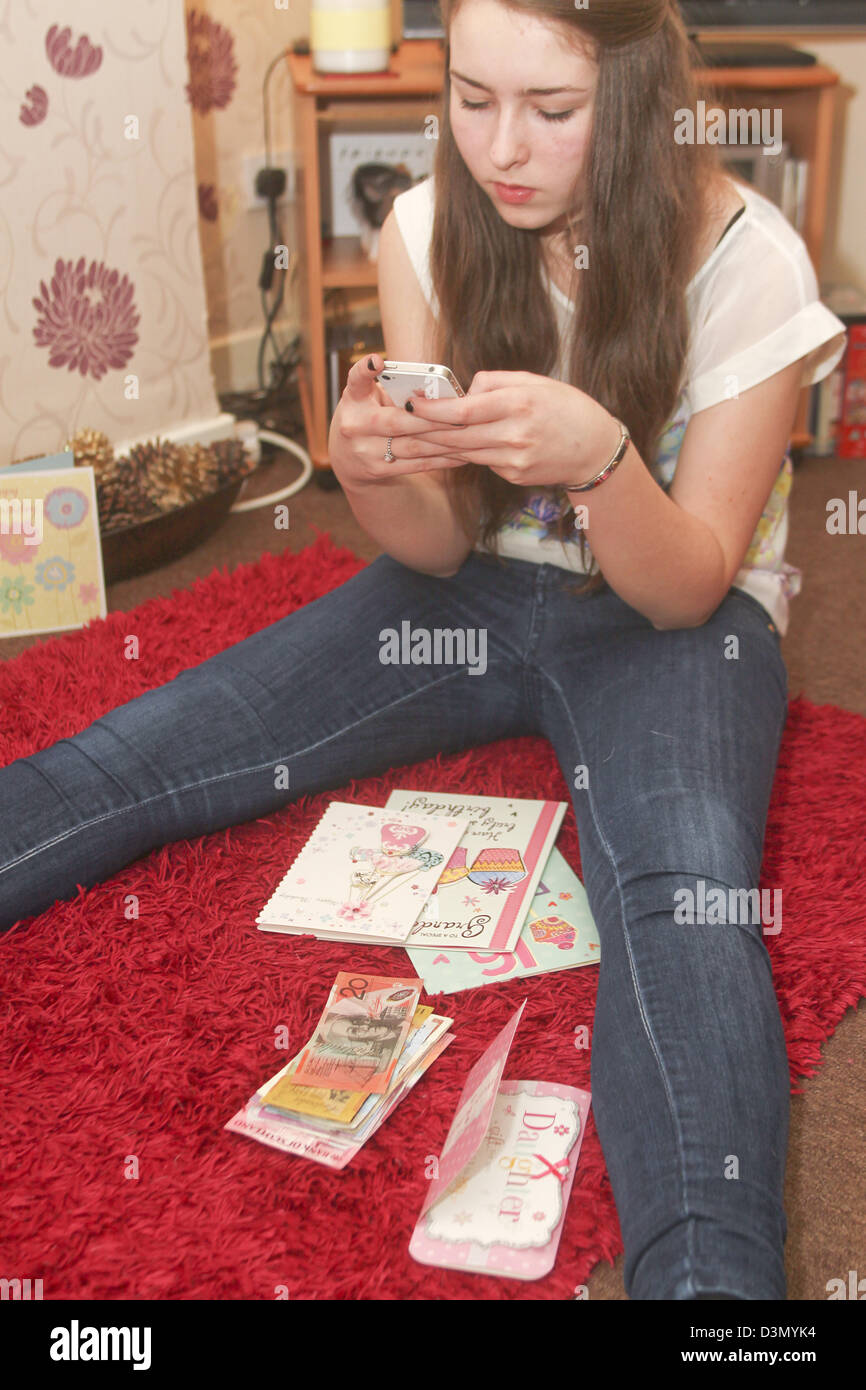 16 year old girl counting up money received for birthday presents