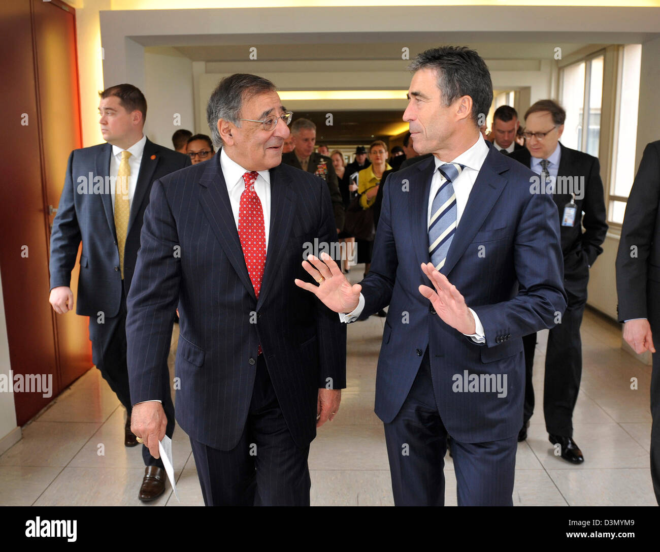 US Secretary of Defense Leon Panetta walks to lunch with NATO Secretary General Anders Fogh Rasmussen at NATO Headquarters Stock Photo