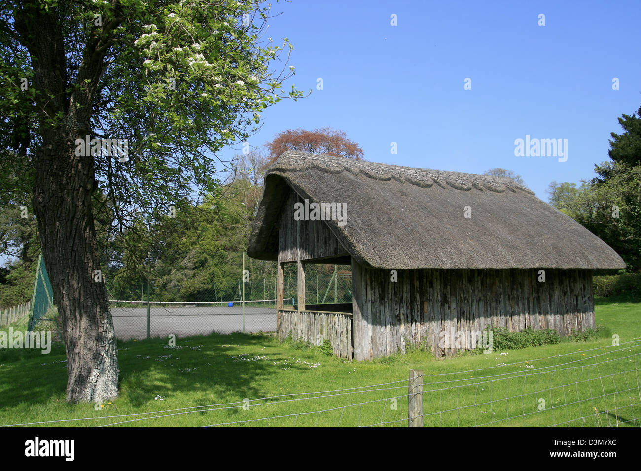 Thatched tennis pavilion Stanway Gloucestershire England UK Stock Photo