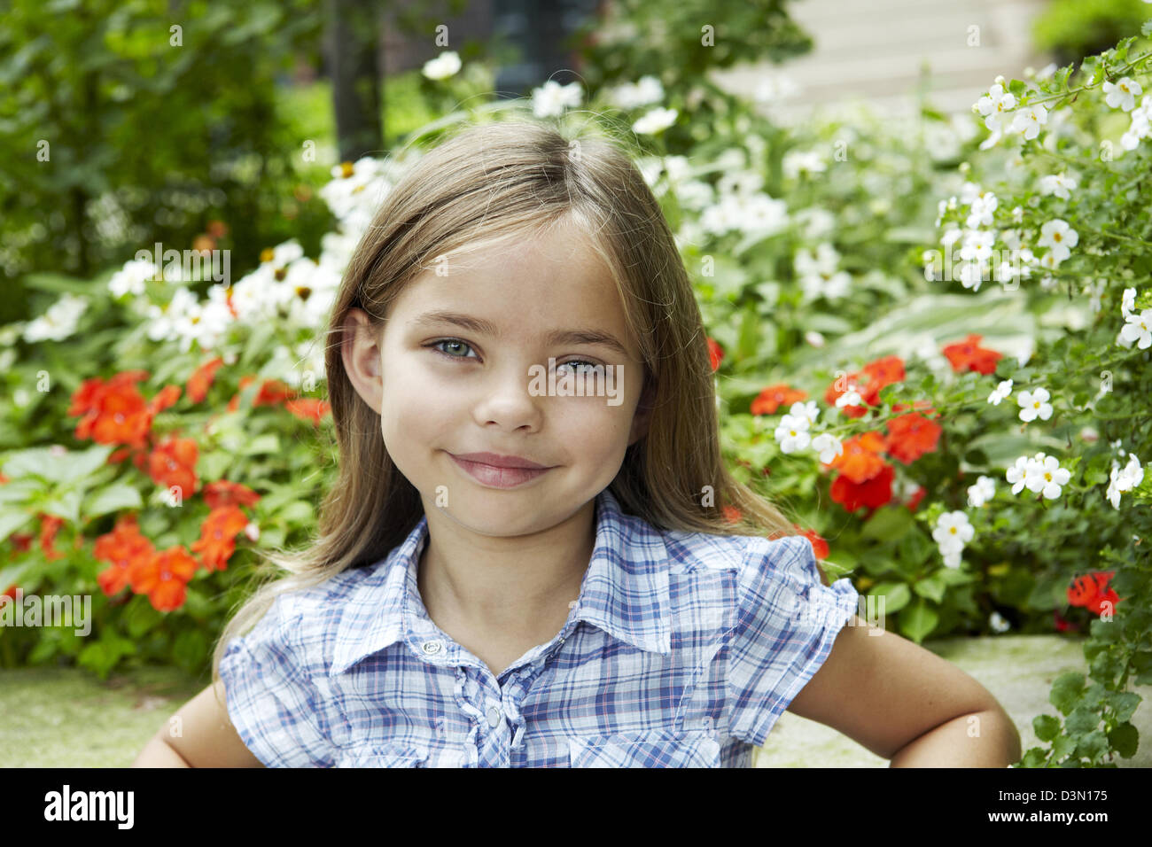 Summer portrait of 7 year old girl - Stock Image