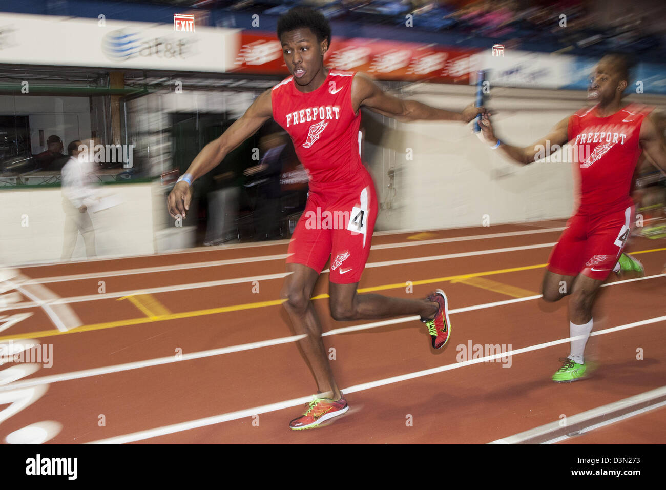 Freeport HS, NY passing the baton in the Long Island HS Boy's 4x400m at the 2013 Millrose Games. - Stock Image