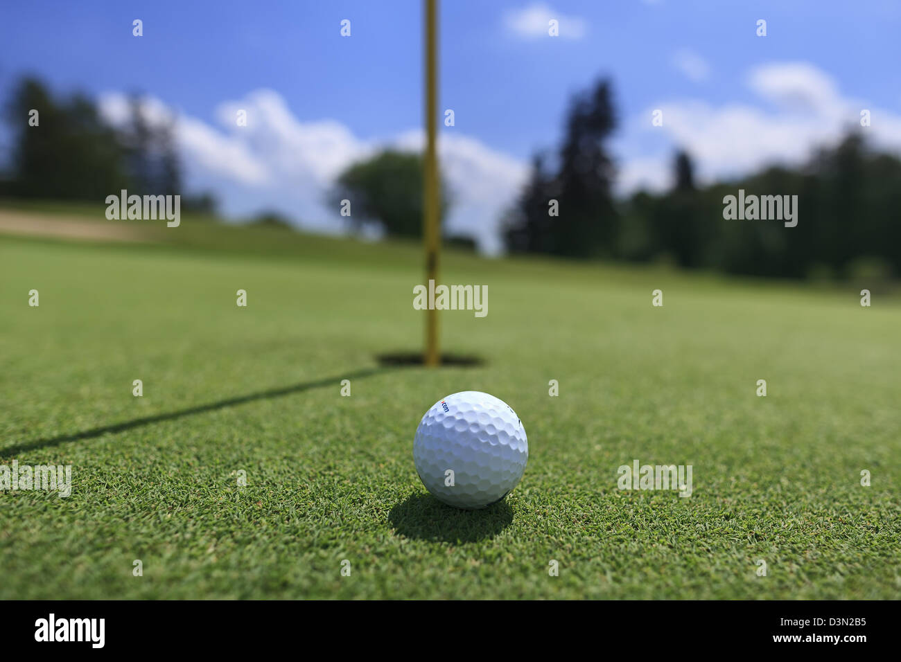 Golf ball on green, close up - Stock Image
