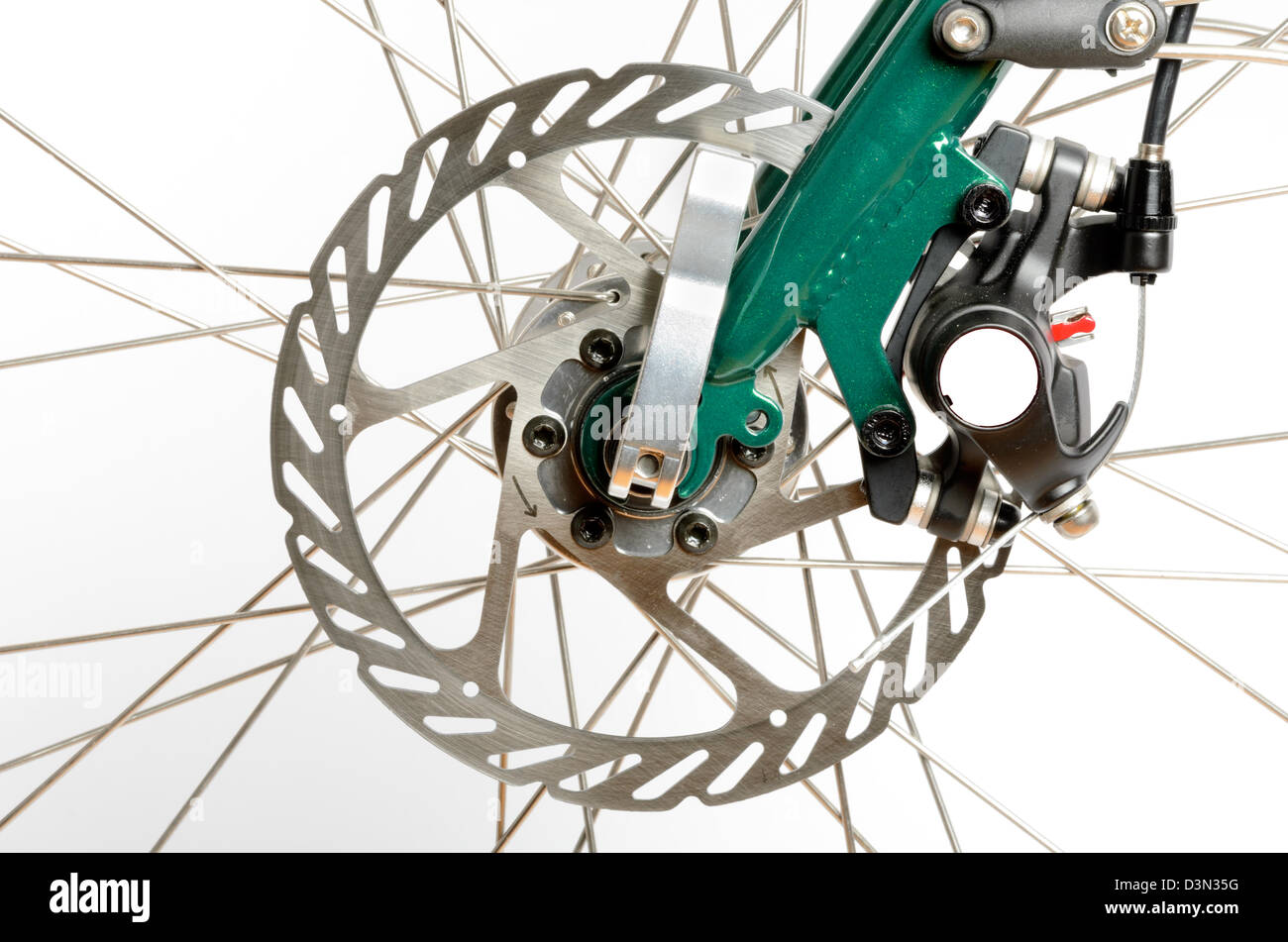 Bicycle disc brake and caliper isolated on a white background - Stock Image