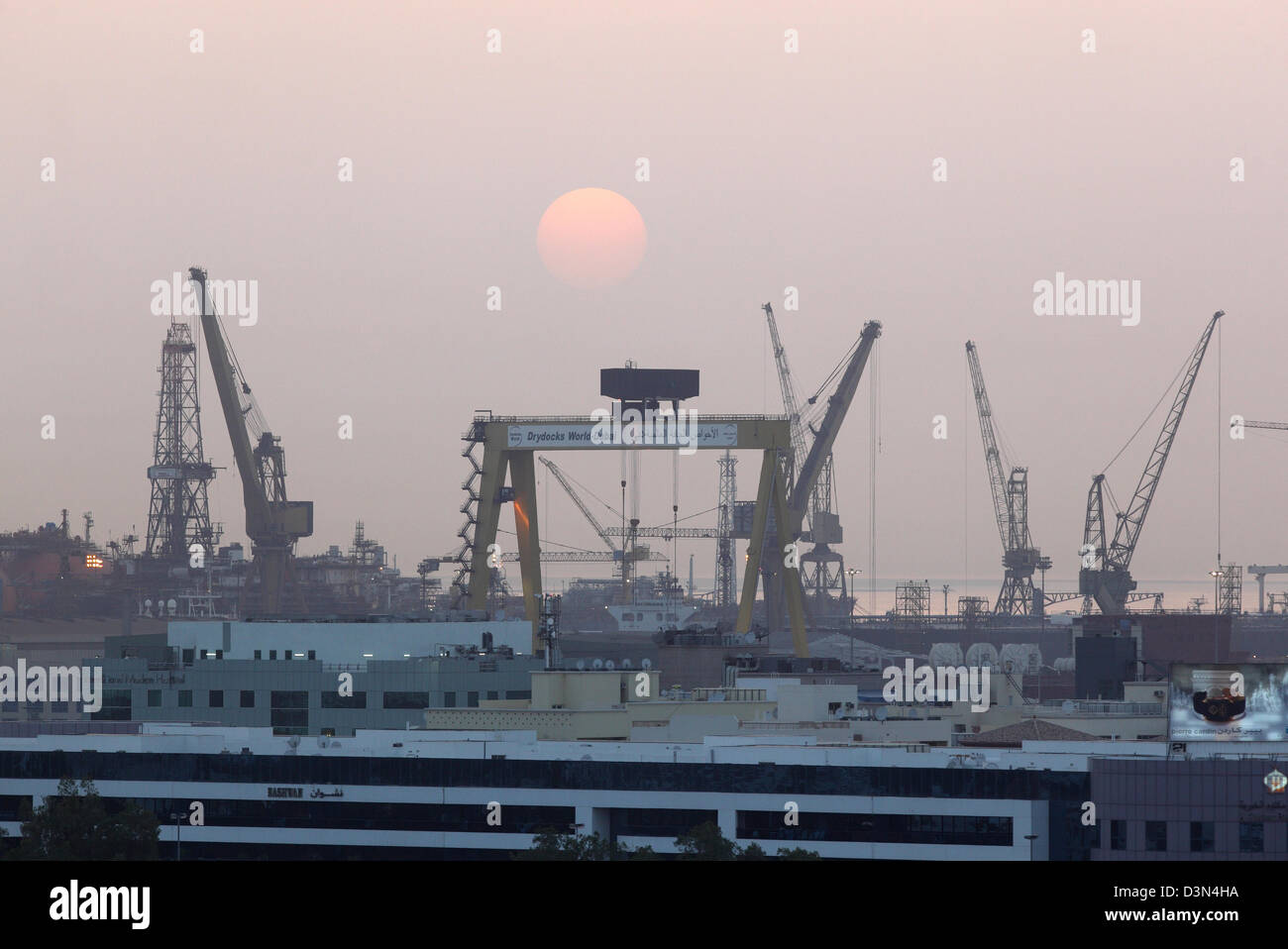 Dubai drydocks stock photos dubai drydocks stock images alamy dubai united arab emirates the drydocks world loading cranes at sunset stock image gumiabroncs Images
