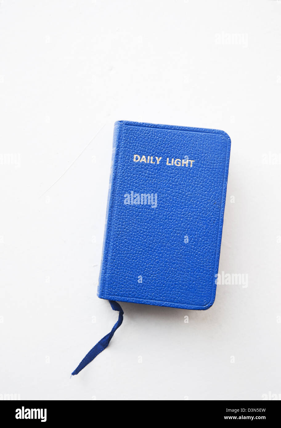 A book with uplifting religious sayings called 'Daily Light' - Stock Image