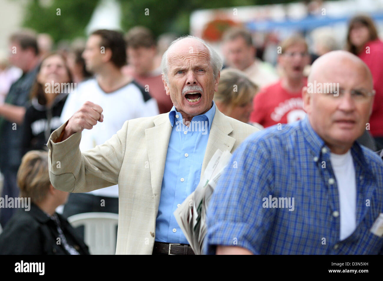 Hamburg, Germany, man on a racecourse cheers on his horse - Stock Image