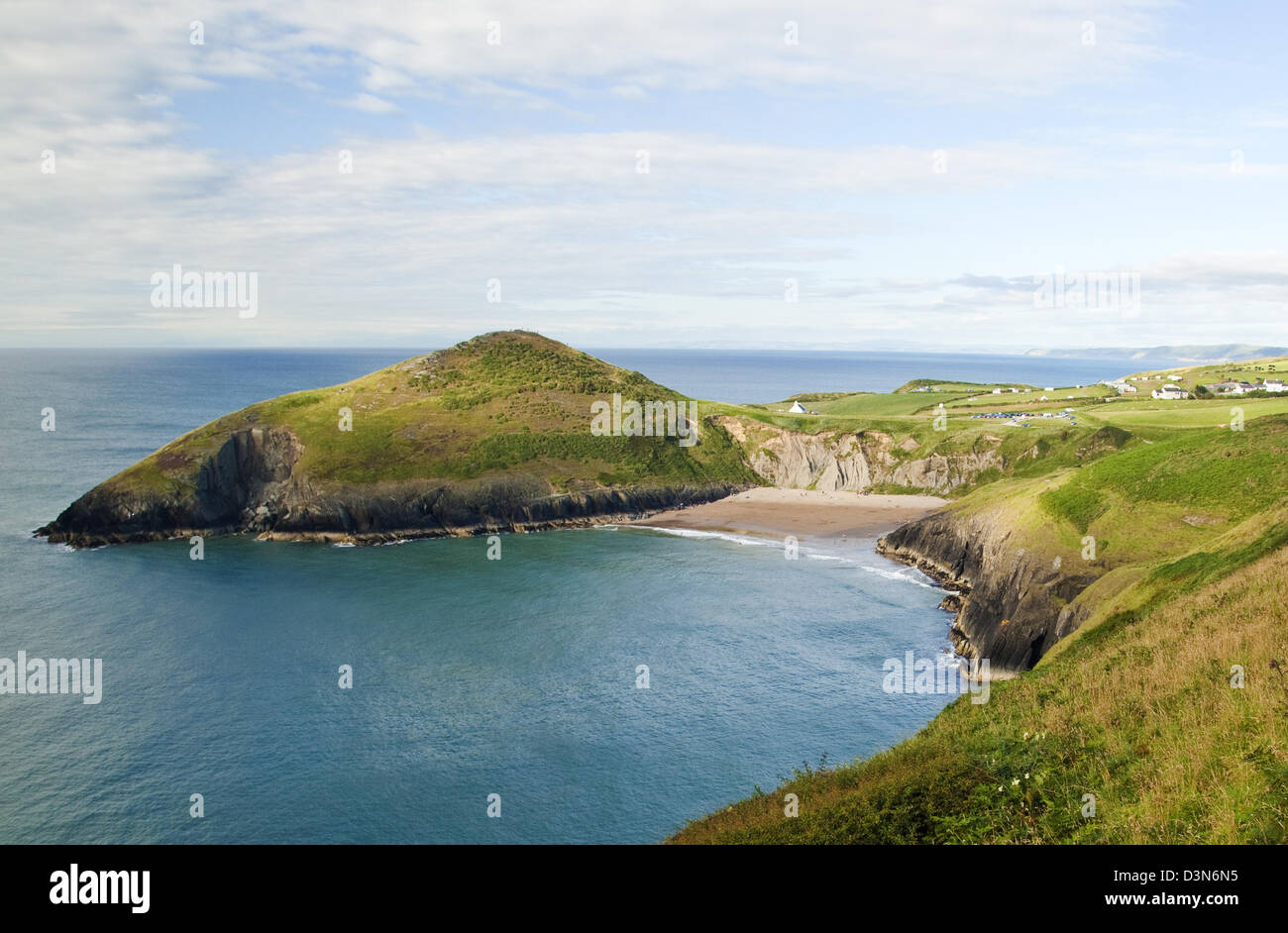 View of Foel-y-Mwnt and beach fron the Cardigan Coastal Path in Ceredigion Wales - Stock Image