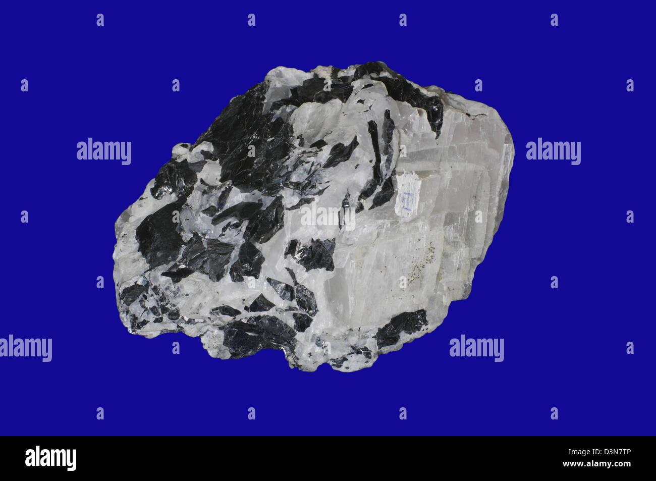 sphalerite, calcite on blue - Stock Image