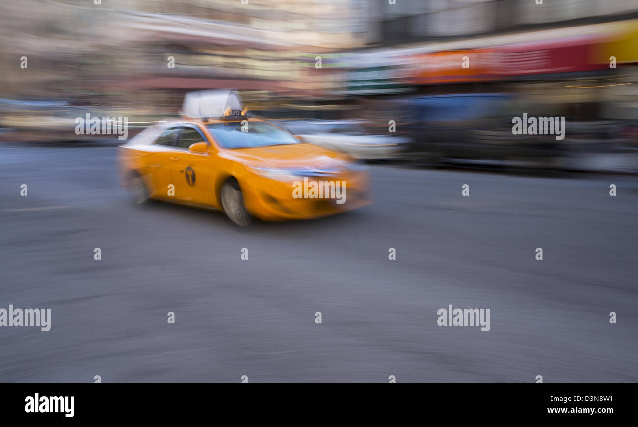 A new hybrid model medallion yellow taxi cab in New York City - Stock Image