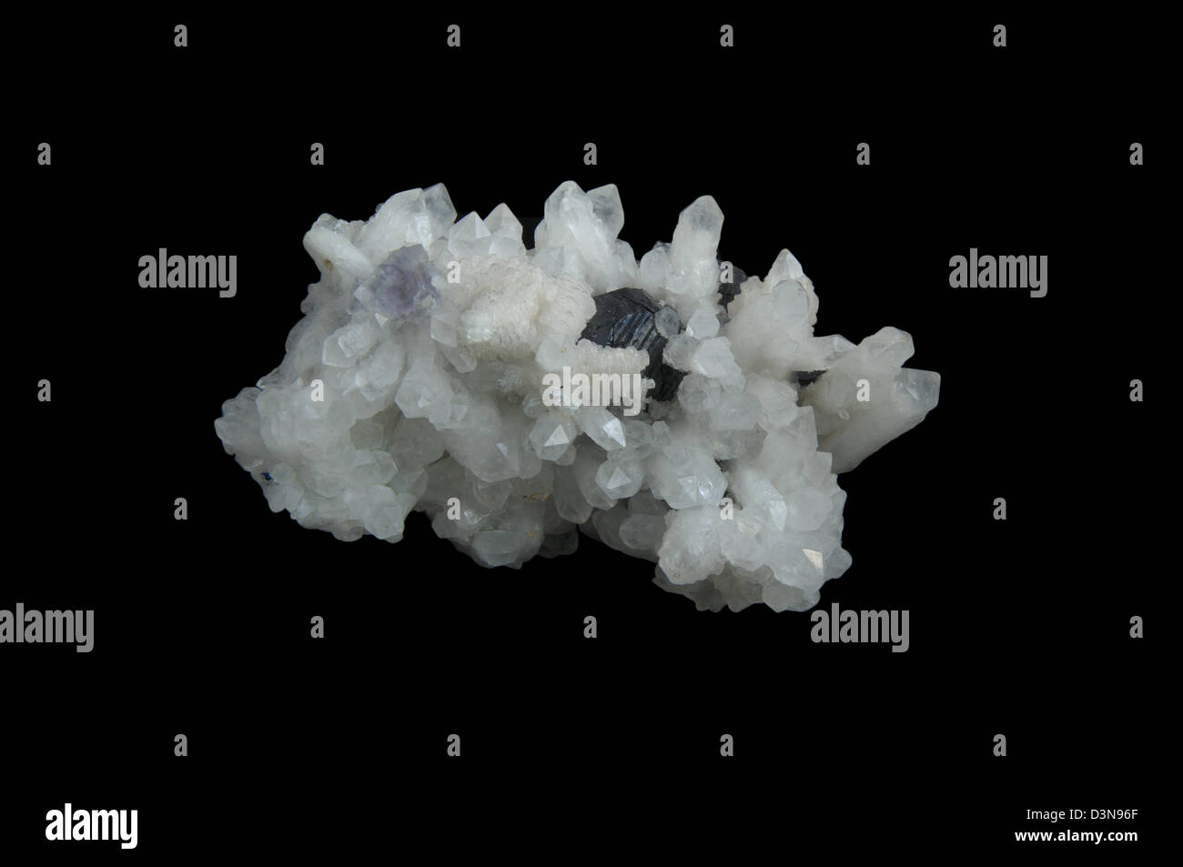 White quartz, sphalerite, calcite isolated on black background - Stock Image