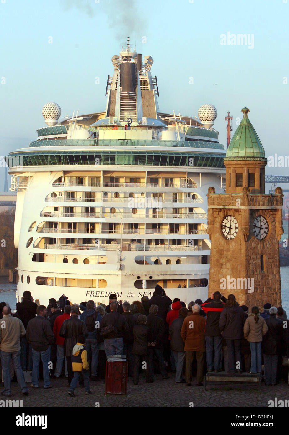 The giant cruiser 'Freedom of the Seas'  is watched by many onlookers on its way to the dock of the shipyard - Stock Image