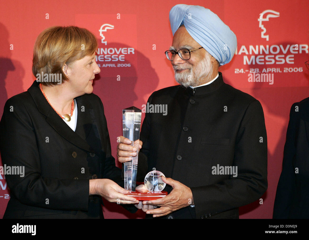 German Chancellor Angela Merkel Hands Over A Gift To Indian Prime Stock Photo Alamy