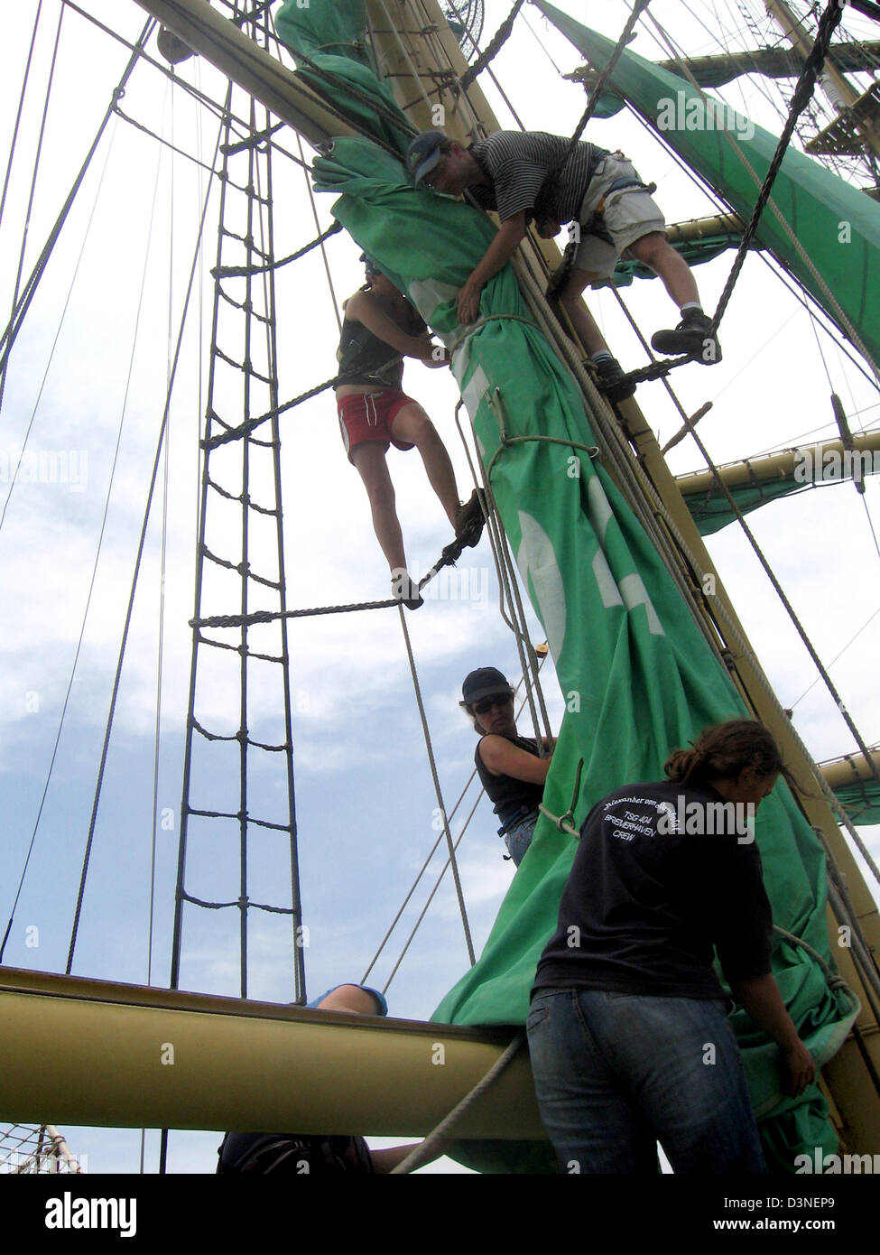The crew strikes the sails aboard the barque Alexander von Humboldt in the Pacific Ocean offshore South America, - Stock Image
