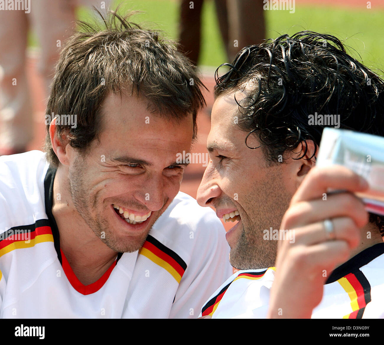 Bayern Muenchen players Mehmet Scholl (L) and Hasan Salihamidzic laugh during their team's friendly match against - Stock Image