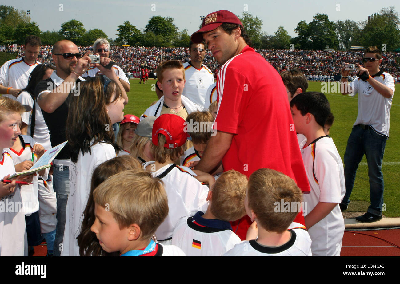 Bayern Muenchen player Michael Ballack signs autographs at his team's friendly match against Bonner SC in Bonn, - Stock Image