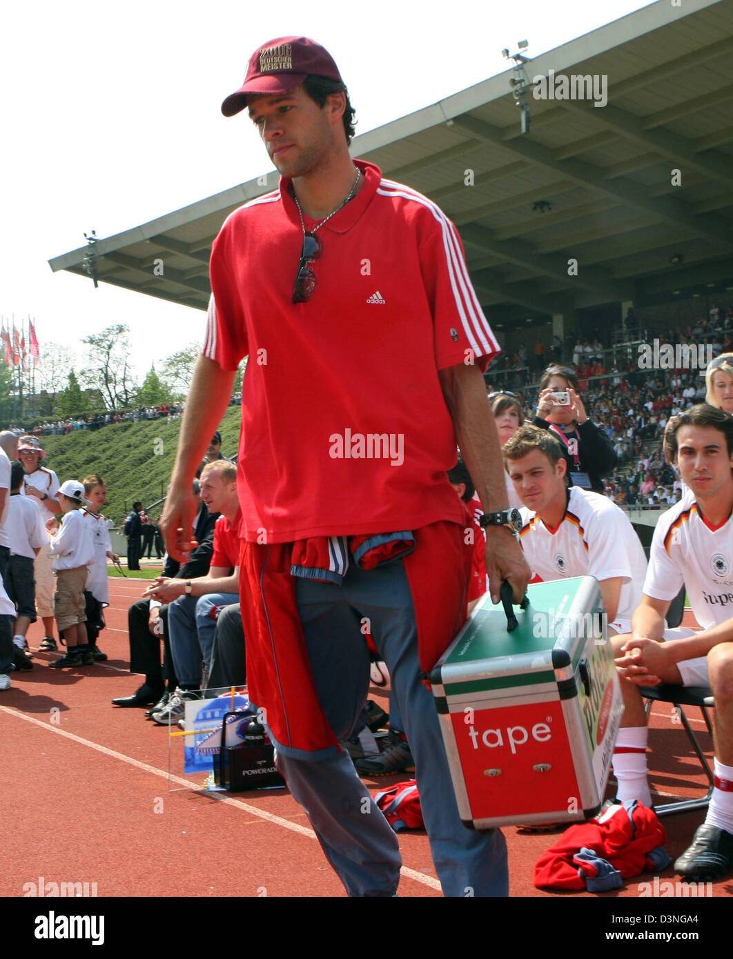 Bayern Muenchen player Michael Ballack carries a doctor's case at his team's friendly match against Bonner - Stock Image