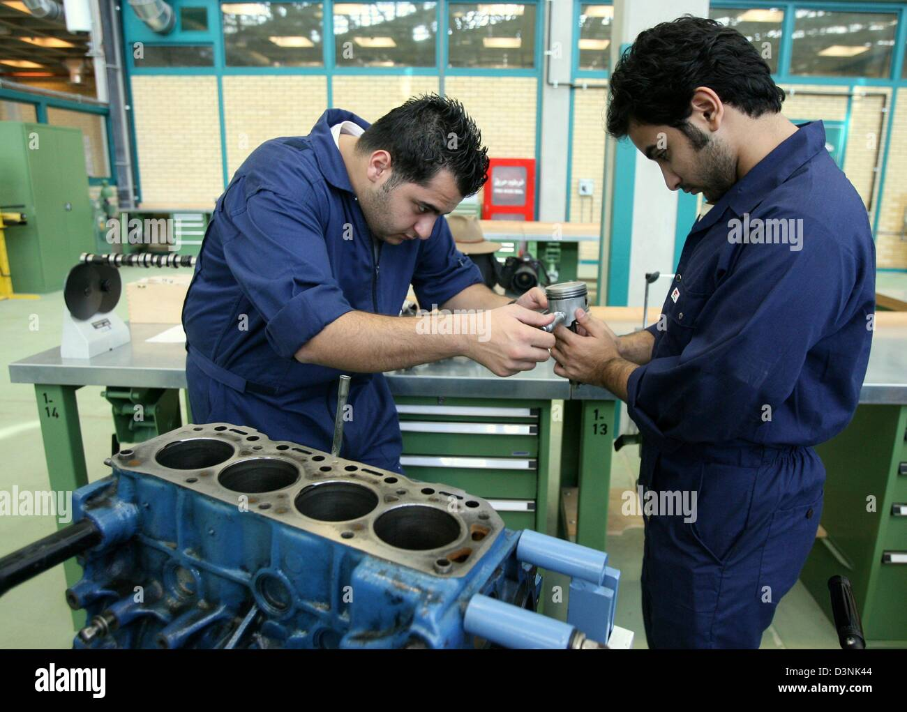 Apprentices measure pistons as part of the vocational training by the GTZ (German Corporation for Technical Cooperation) Stock Photo