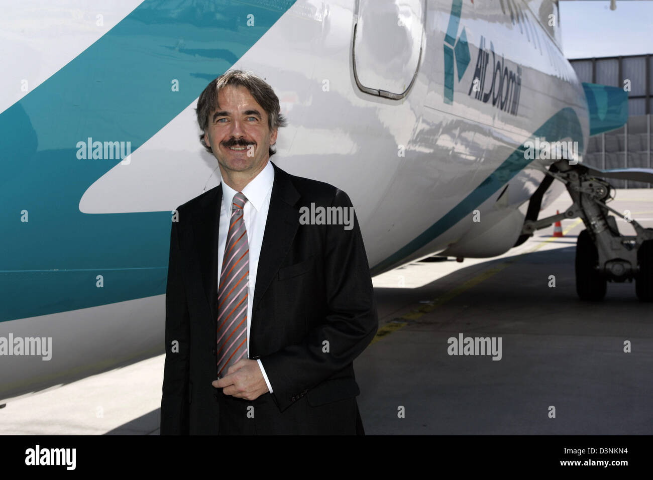 Air Dolomiti President and CEO Michael Andreas Kraus smiles during the christening of BAe 146-300 jet at Munich - Stock Image