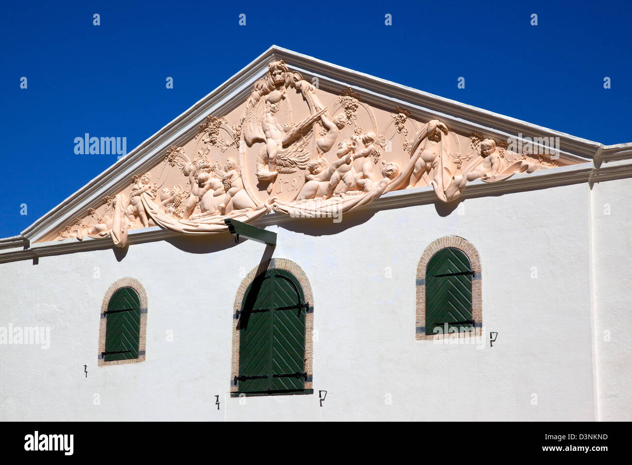 The wine cellar pediment at Groot Constantia, the finest surviving example of Cape Dutch architecture in South Africa. - Stock Image