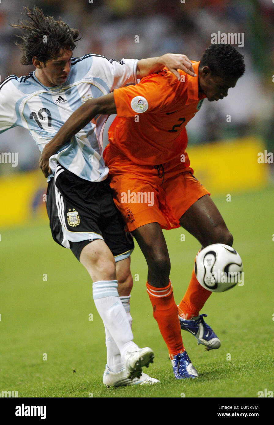 Argentinian national soccer player Lionel Messi (L) and Dutch Kew Jaliens vie for the ball during the FIFA World - Stock Image