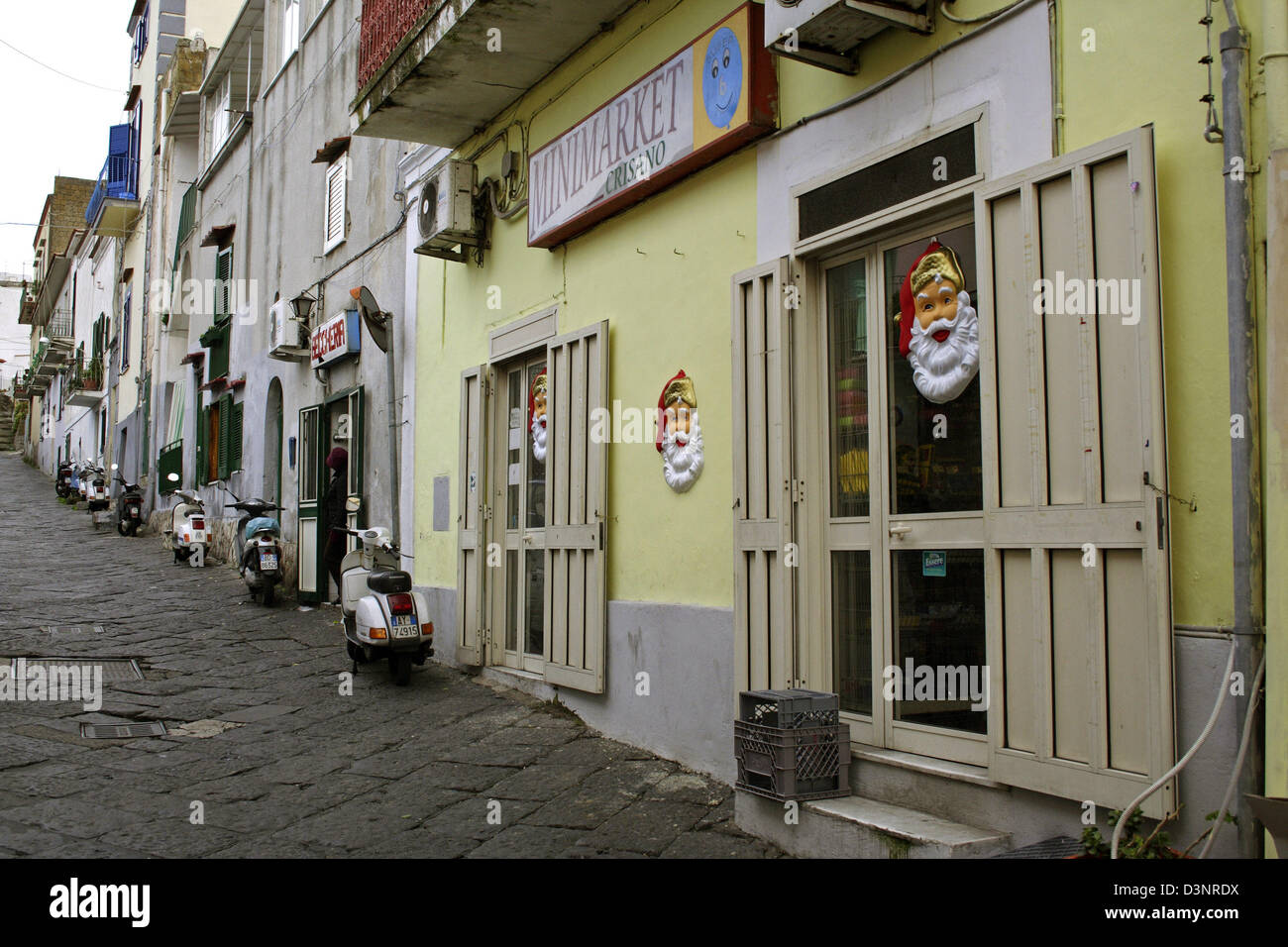 A Minimarket Decorated With Santa Claus Masks In Procida, Italy, 10  December 2005. Procida Is One Of Italyu0027s Smallest Islands Next To Capri And  Ischia.