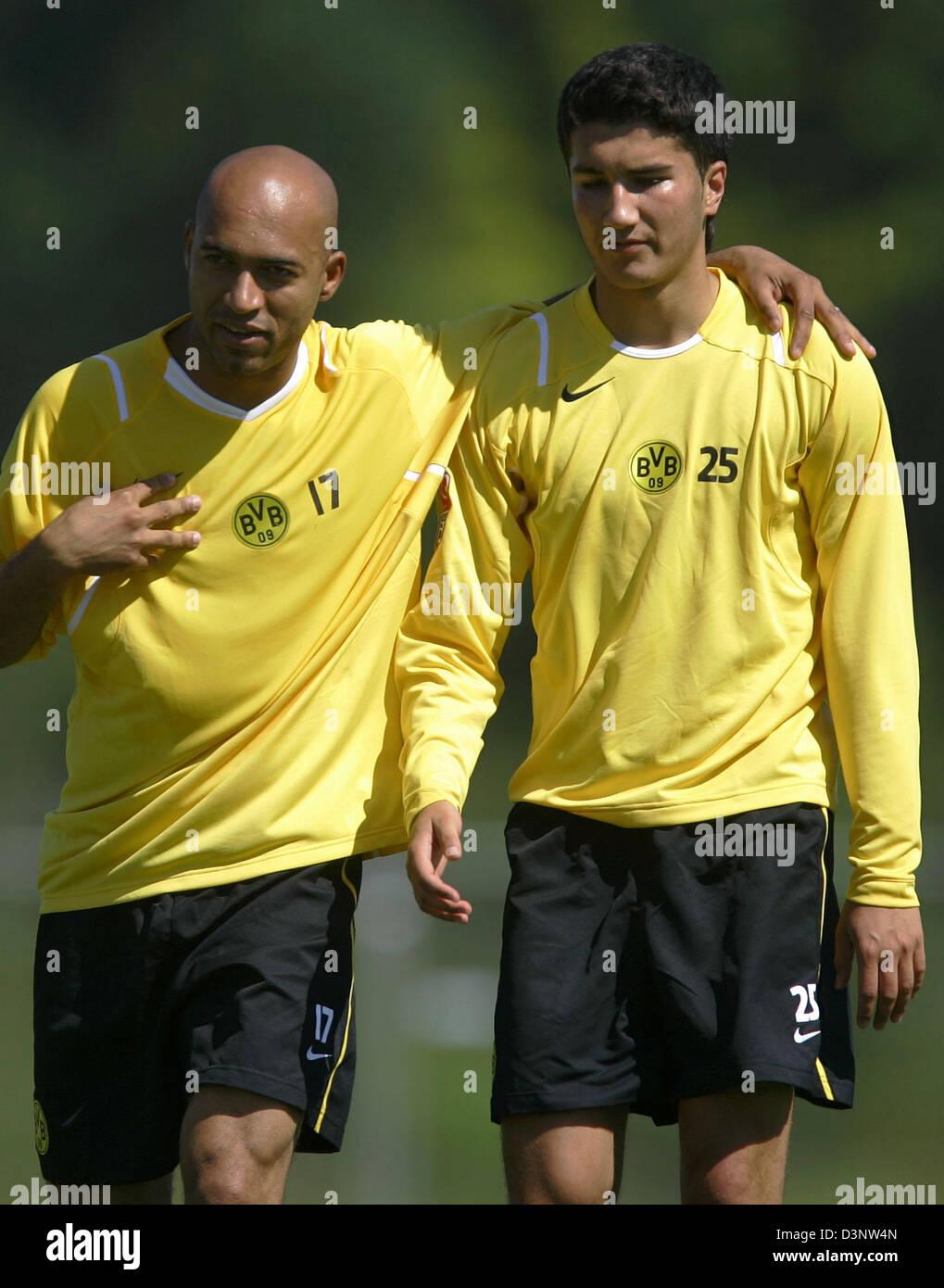 Soccer pros (L-R) Leonardo Dede and Nuri Sahin of Bundesliga club Borussia Dortmund shown during the first training - Stock Image