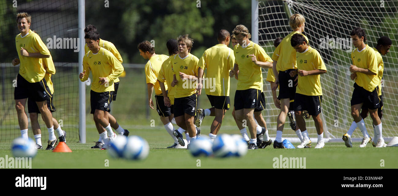 The soccer professionals of Bundesliga club Borussia Dortmund run during their first training session prior to the - Stock Image