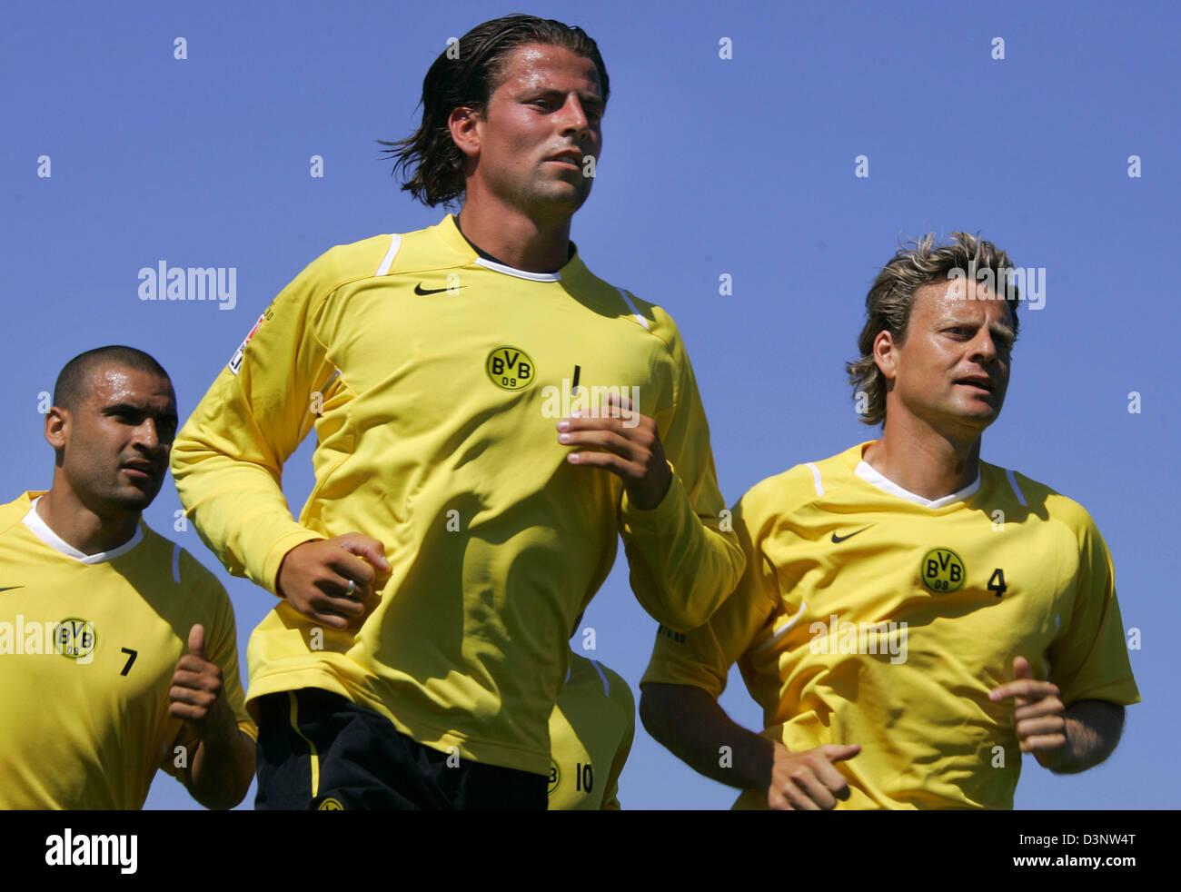 Soccer pros (L-R) Delron Buckley, goalkeeper Roman Weidenfeller and Christians Woerns of Bundesliga team Borussia - Stock Image