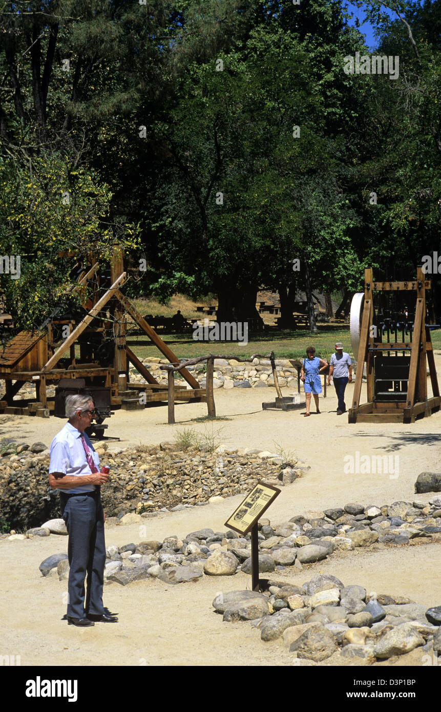 Visitors explore the mining exhibits at Marshall Gold Discovery State Historic Park, Coloma, California, USA. - Stock Image