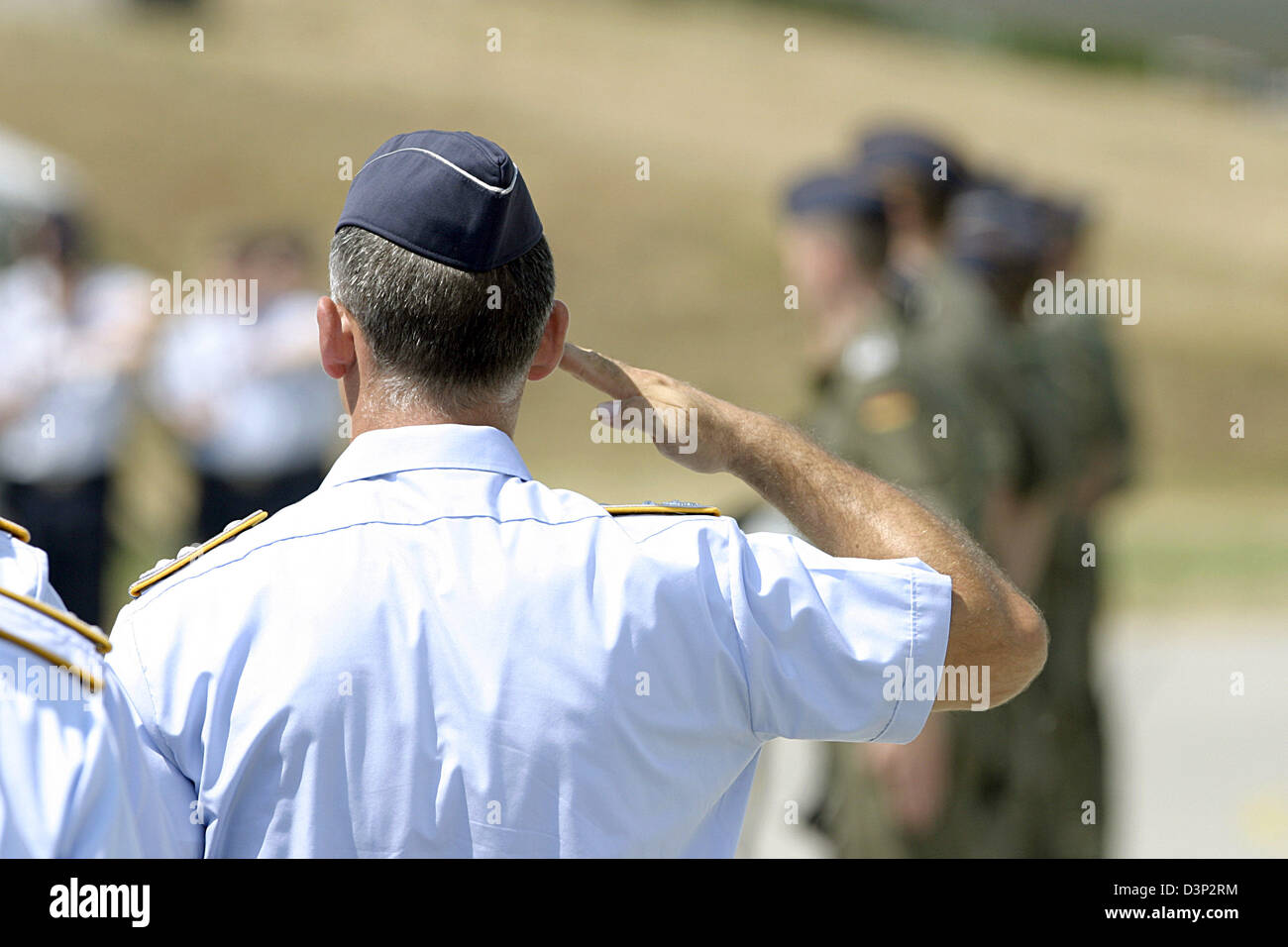 A captain of the German Air Force salutes at the ceremonial handover of Eurofighter pursuit jets to the fighter - Stock Image