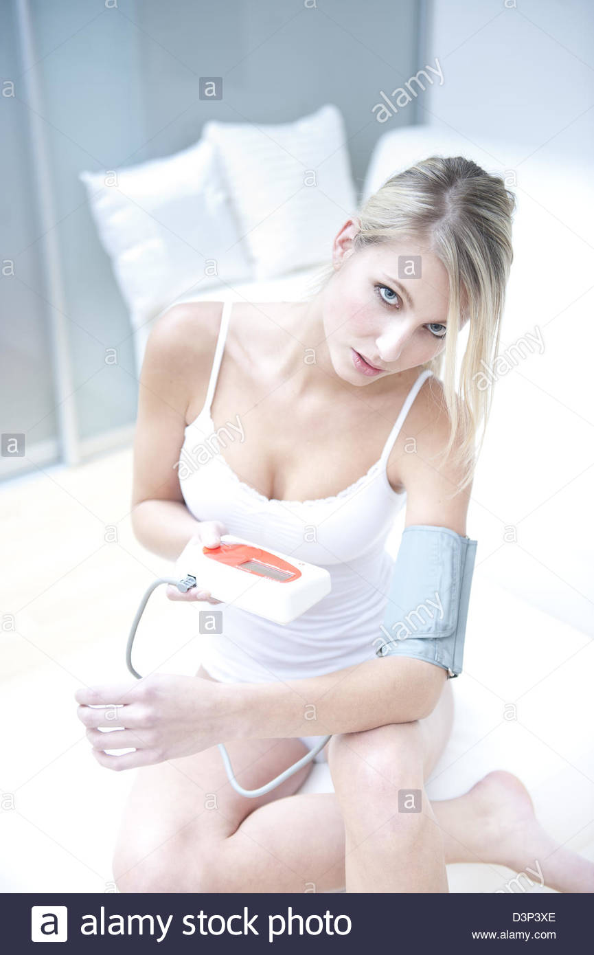 Young woman with manometer - Stock Image