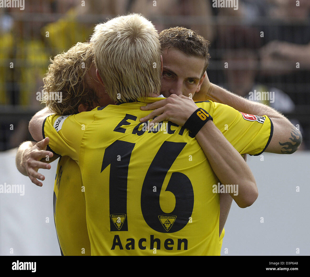 Jan Schlaudraff (L), Sascha Dum and Marius Eber of Aachen celebrate after the 2-O during the Bundesliga match Alemannia - Stock Image