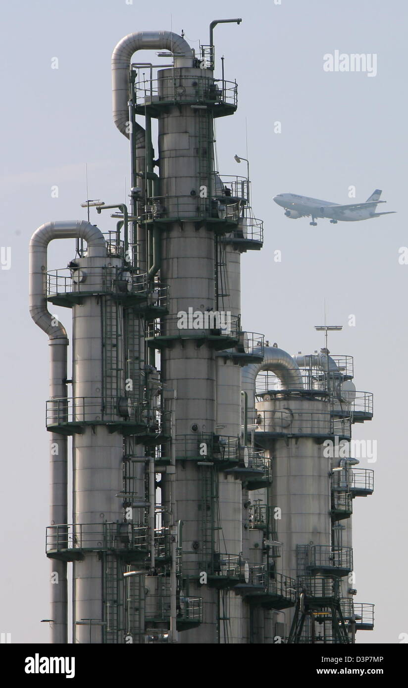 A civil aircraft flies by production systems of chemical engineering plant of Ticona in Kelsterbach, Germany, 23 - Stock Image