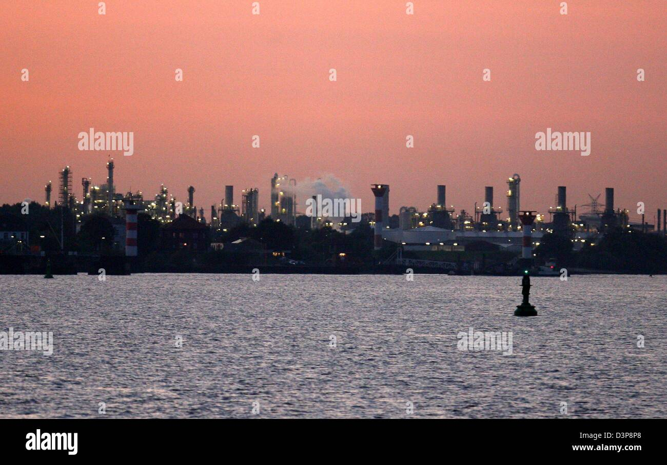 The photo shows a Dow Chemical plant in front of the red