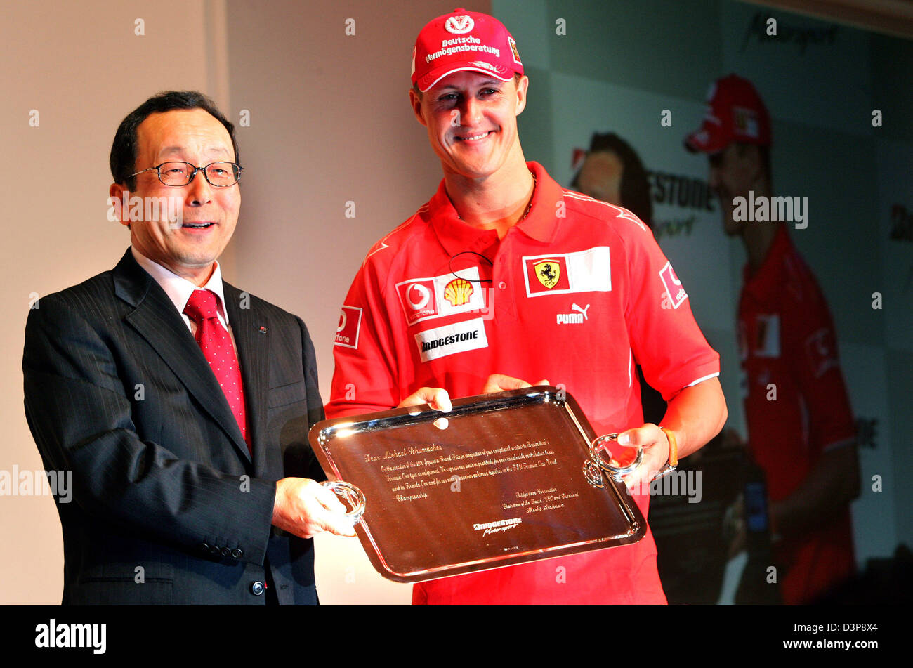German Formula One driver Michael Schumacher (R) of Scuderia Ferrari